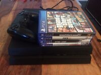 PS4 + 4 games and controller £230 Ono