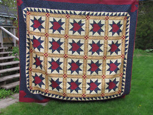 Handcrafted, signed patchwork quilt.
