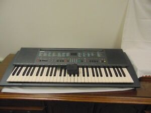 YAMAHA KEYBOARD WITH CASE;  $300 or trade