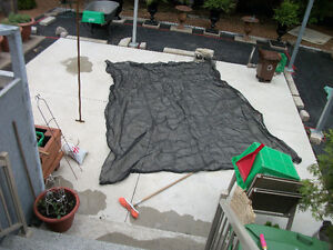 Black net trailer cover 9 feet x 11 feet (no rope or cords) 30$