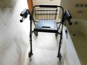 Collapsible mobility walker with basket and seat