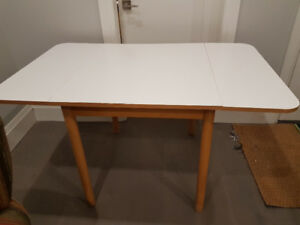 Dining Table, adjustable. $40. Open House Sun, Dec 9th 10-4ish