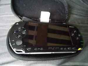 Psp with protective case and games plus movie.  Kitchener / Waterloo Kitchener Area image 2