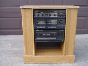 Vintage AM/FM Stereo and Cassette Player in Cabinet