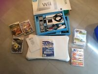 Wii console and balance board, accessories and games