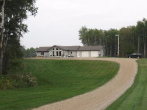 Near Duck Mountain 145 Acres with 1,840 SF Bungalow