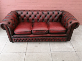 An Oxblood Red Leather Chesterfield Three Seater Sofa