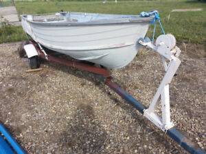 12 ft aluminum boat with 9.8 motor, oars, fishfinder and trailer
