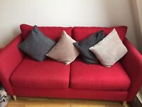 Red 2 seat sofa.