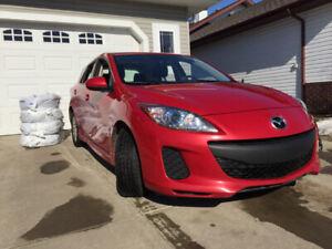 2013 Red Mazda 3 GS Hatchback.
