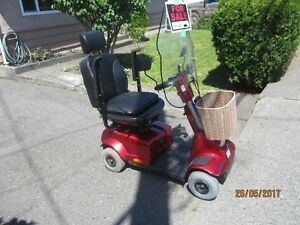 4 wheel red scooter