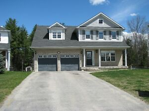 Gorgeous 4 bdrm home in popular 5th line subdivision in Angus!