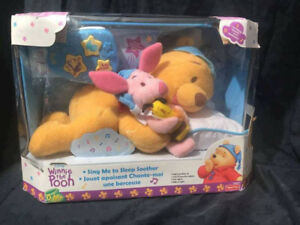 Winnie the Pooh nap & bedtime soother!  Plays a tune, sings