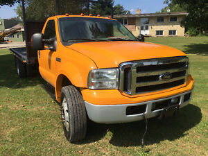 Ford F-550 Pickup Truck with deck and boss plow