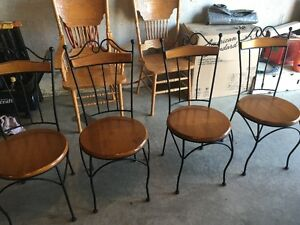 Beautiful and rarely used oak and rod iron dining set