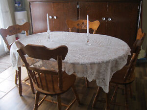 Oval Ajustable Table and Four Chairs
