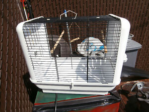 1 bird cage in good shape left by old owner asing $30  514-803-4