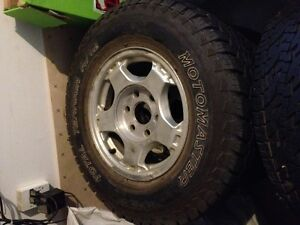 Set of 4 tires (slightly used) on GM rims