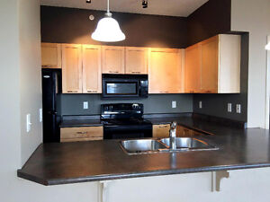 Available Now, Walk to LRT, concrete building in Clareview