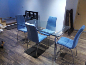 Glass dinning table and 4 chairs plus accent chair
