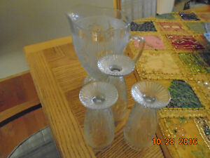 Iris Water Pitcher and 3 stemmed glasses.  Depression Glass