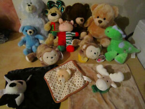 Assorted stuffed animals with music and rattles