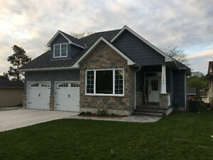 1.5 Storey Custom Built Home on 1/2 Acre Lot Built in 2014
