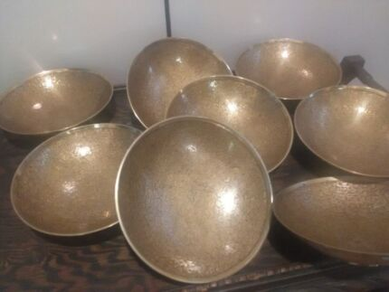 8 heavy rice serving brass bowls. nice design