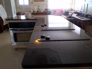 Large slab of black pearl granite countertop