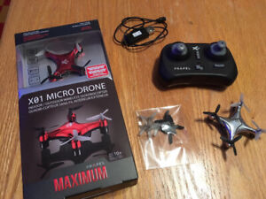 2x micro drones - Multiple spare parts, chargers