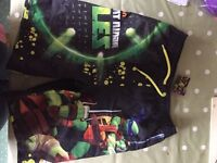 Size 7-8 TMNTurtles swim shorts. Never worn.