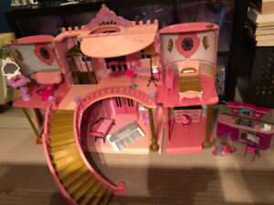 Princess Barbie House with extra Barbie furniture.
