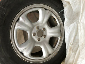 """16"""" (inch) silver steel rims with winter tires"""