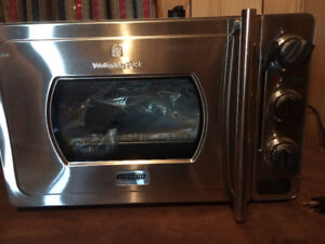 New, never used Wolfgang Puck pressure oven. $250.00