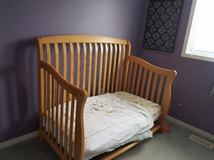 Excellent crib. Comes with mattress and 2 comforters and a sheet