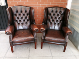 A Pair Of Dark Brown Leather Chesterfield Library Armchairs