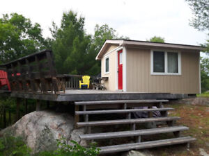 WATERFRONT COTTAGE FOR SALE WITH 5.6 ACRES OF LAND