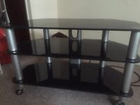 Black glass tv stand on wheels