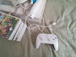Wii system + Wii Fit + games + controlers Cambridge Kitchener Area image 4
