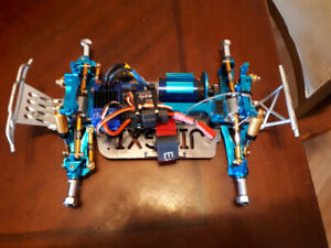 WL Toys A979 with full aluminum & traxxas brushless upgrades.