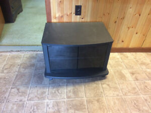 Small tv stand / table with wheels . Done need $20.