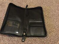 Black leather document holder.