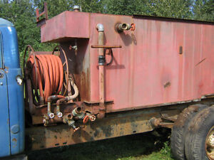 1250 Gallon Water tank and Firehoses with nozzles