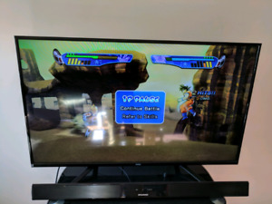 """50"""" Slim Full HD TV w/ PS3, TV stand, HDMI Cable & 3 Blu-ray DVD"""