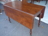 solid wood drop leaf dining table on casters