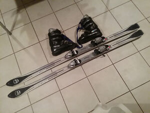 downhill skis, boots, bindings, poles