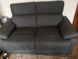 2 x two seater electric recliner sofas, almost new