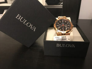 round gold-colored Bulova chronograph watch with box