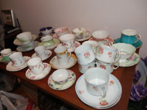 55 CHINA CUPS AND SAUCERS