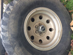 32x11.50r15 m/t trail cutter tires on american racing rims